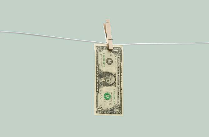Dollar bill hanging on clothesline